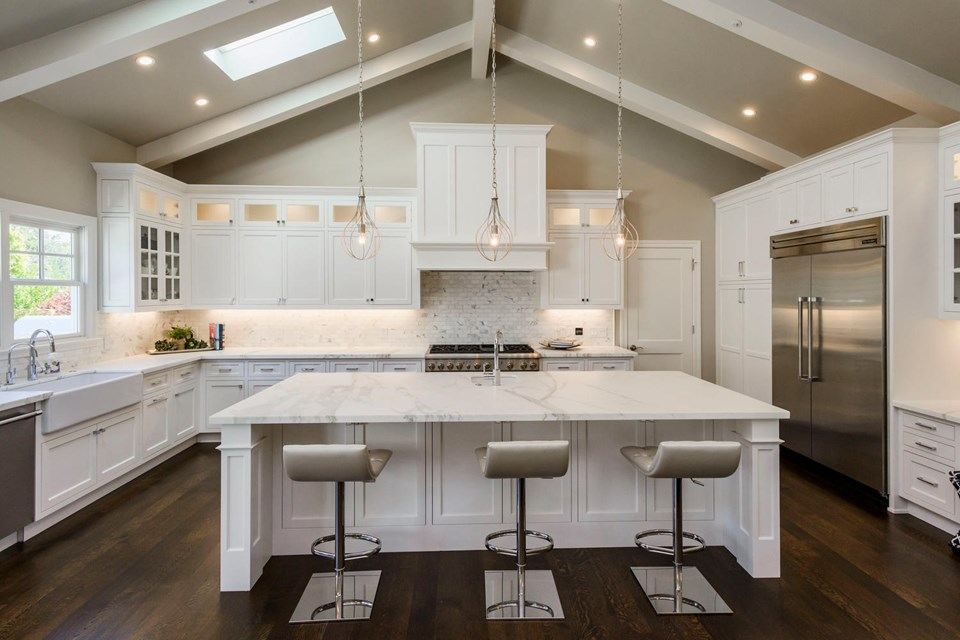 expansive kitchen with calacatta countertops and top-of-the-line appliances
