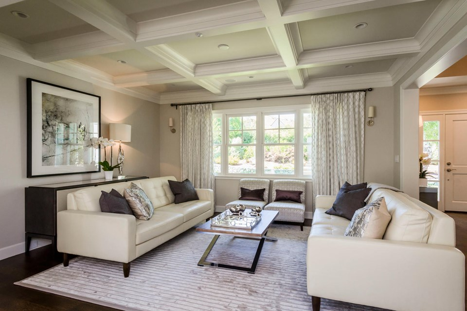 formal living room with box-beamed ceilings